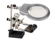 Helping hand with magnifying glass and light
